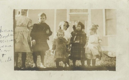 Ronald and Grace's children: Vivian, Gordy, Miriam holding Keith, Eddie scowling and Jean