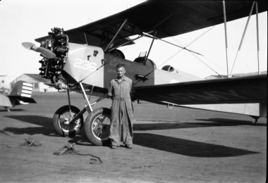 Keith by an airplane circa 1931